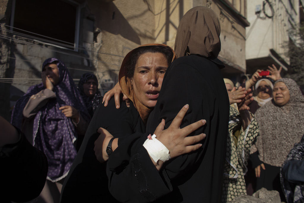 Women mourn during the funeral of the boys who got killed by an Israeli naval bombardment in the port of Gaza cry during their funeral in Gaza City, 16 July 2014. Four boys died on the spot during an Israeli naval bombardment in the port of Gaza, a fifth boy died shortly after the attack in hospital. Israel stepped up its attacks on 16 July by bombing the homes of Hamas leaders after the Islamist movement rejected a truce proposal and instead launched dozens more rockets into Israel.((Photo by Heidi Levine/The National/Sipa Press).