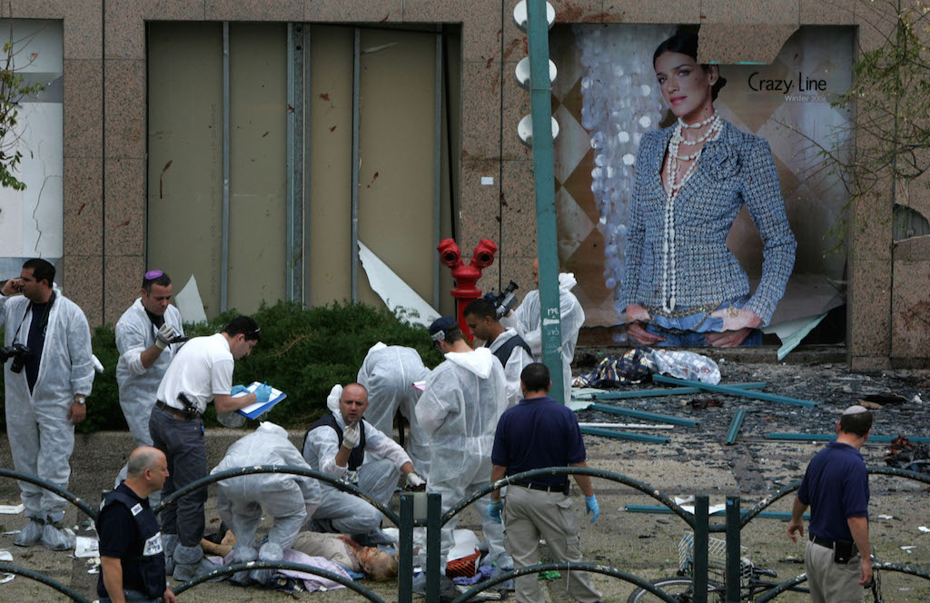 Israeli police at trying to identify victims at the scene outside the Hasharon shopping mall in the Israeli city of Netanya after a suicide bomber blew up killing 5 and wounding dozens Dec.5,2005. (Photo by Heid Levine/Sipa Press).